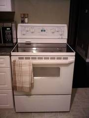 Fridge,  stove and washer and dryer